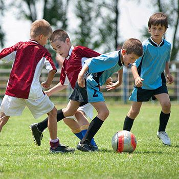 Conceptual Image; Children playing soccer