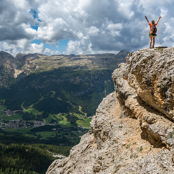 Woman Mountain Climber Reaching Summit; Conceptual Image