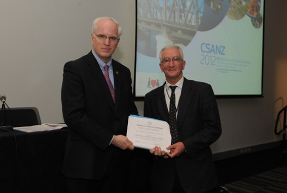 Jim Cameron receives a certificate on the formation of the ACC Chapter in Australia and New Zealand from ACC President Elect John Harold